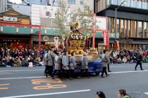 men pushing a portable shrine