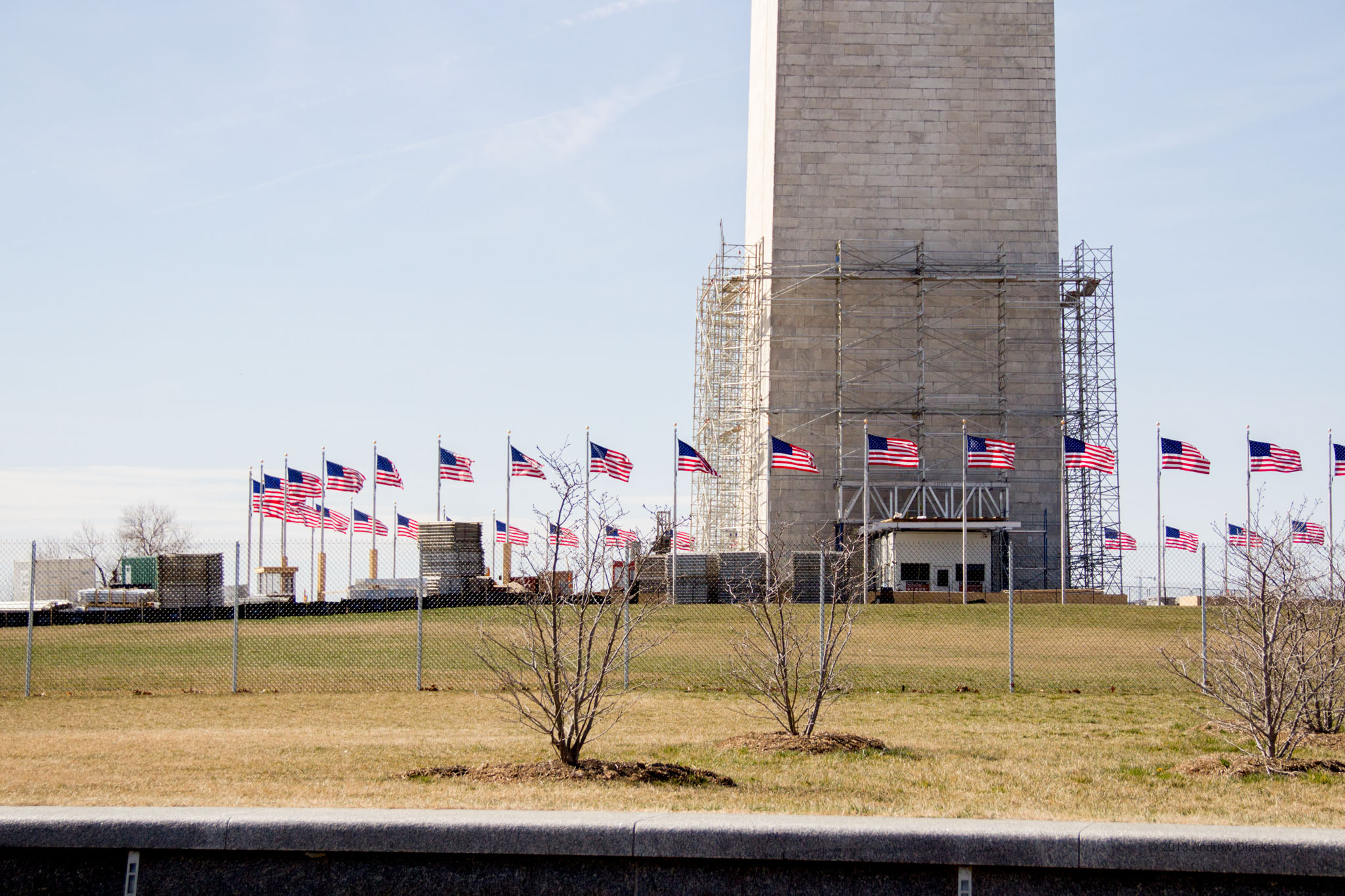 base of the Washington Monument with flags and scaffolding