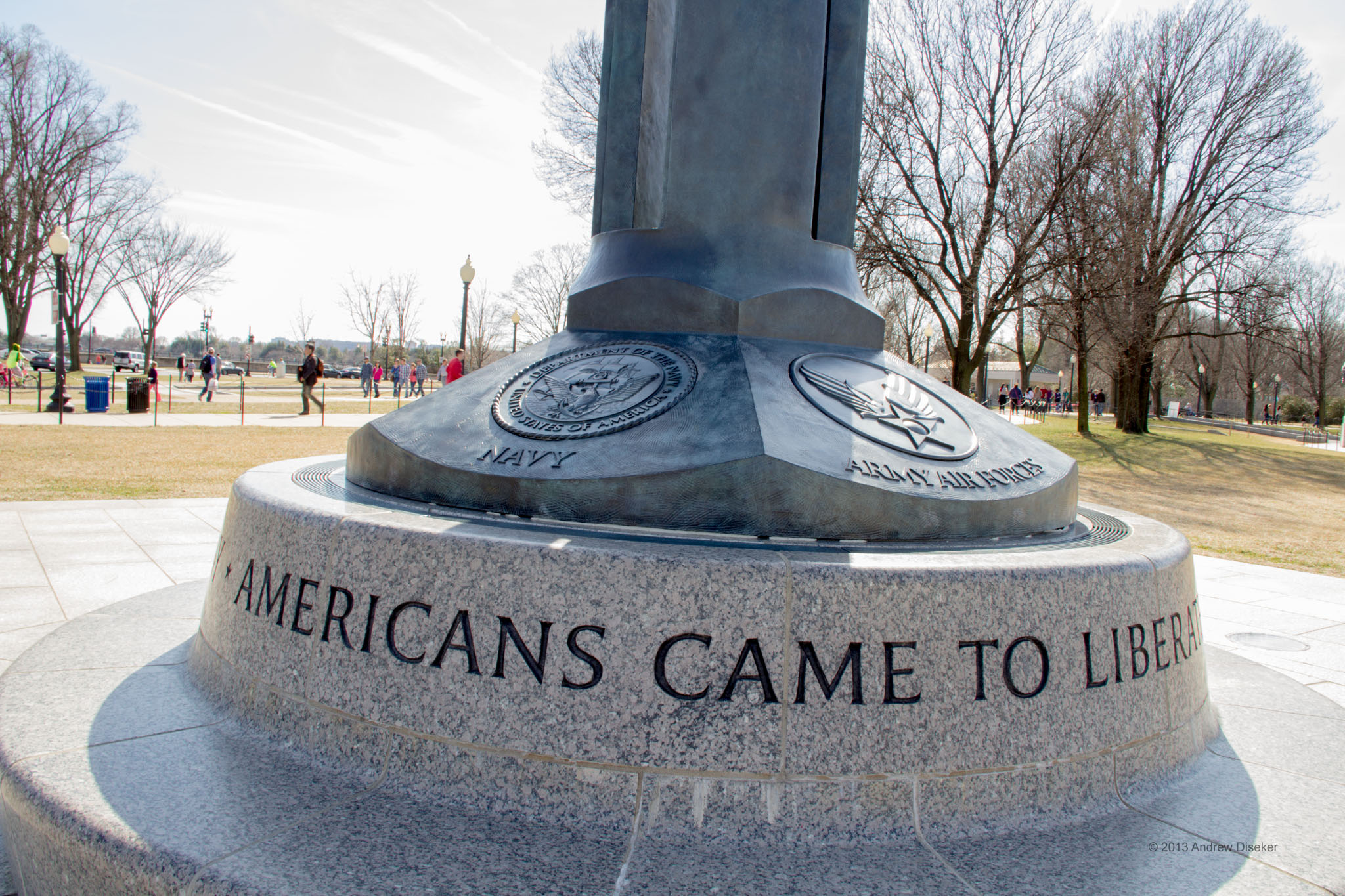 "base of flagpole with inscription ""Americans came to liberate"""