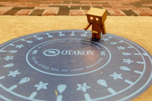 "Danboard checks out the Otakon ""ice cold waterworks"" sign"